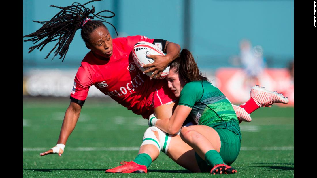 Canada's Charity Williams, left, is tackled by Ireland's Amee Leigh Murphy Crowe during the World Rugby Women's Sevens Series in Langford, British Columbia, on Saturday, May 12.