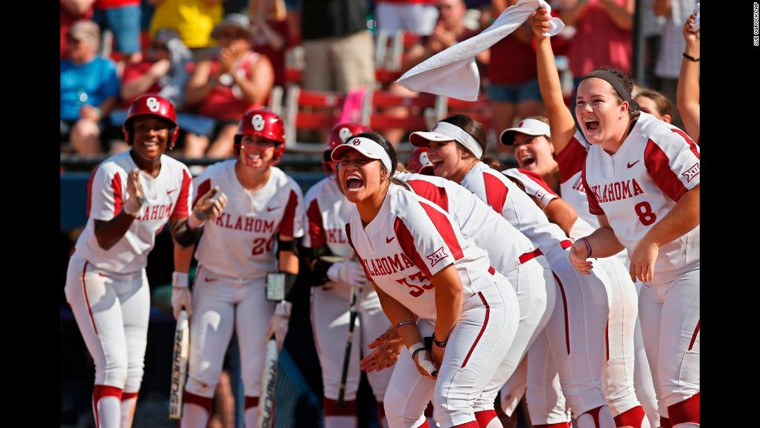 Oklahoma players celebrate at home plate as they wait for Nicole Pendley after a home run by Pendley against Baylor in the third inning during the championship game of the Big 12 softball tournament in Oklahoma City on Saturday, May 12.