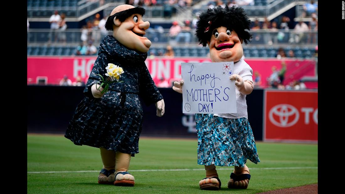 San Diego Padres mascot the Swinging Friar, left, walks on the field with another mascot dressed as the friar's mother to celebrate Mother's Day before a baseball game against the St. Louis Cardinals in San Diego on Sunday, May 13.