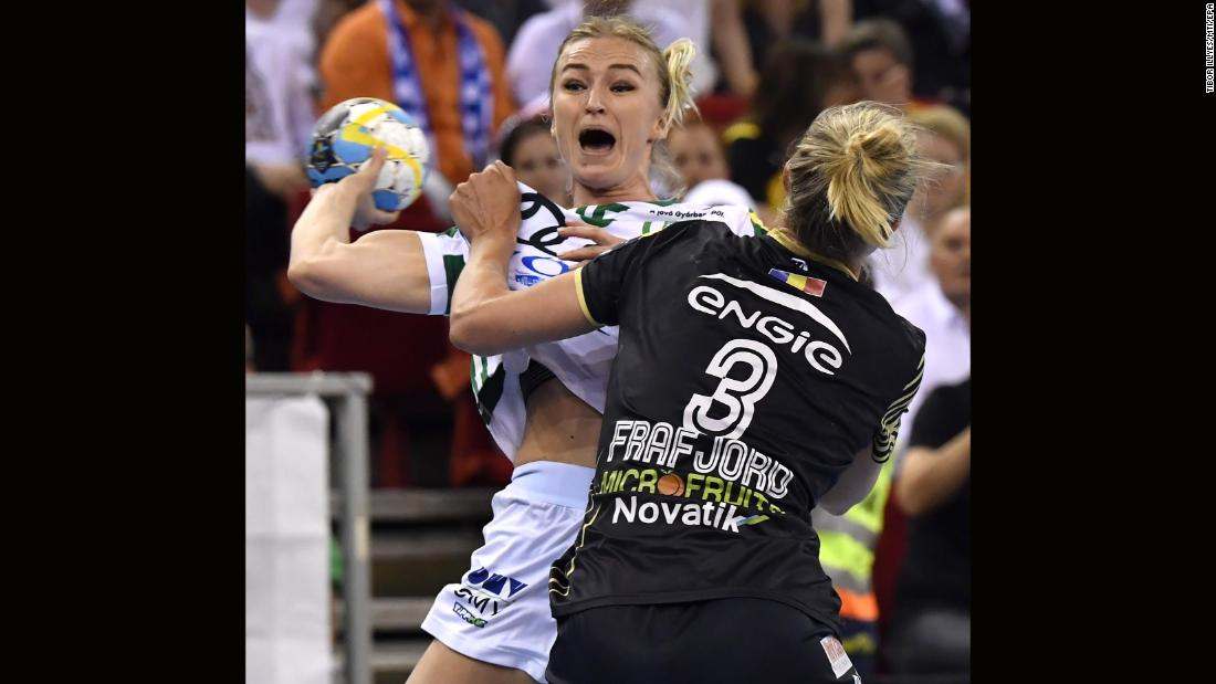 Stine Bredal Oftedal of Gyori Audi ETO of Hungary, left, in action against Marit Malm Frafjord of CSM Bucuresti of Romania during their EHF Women's Handball Champions League Final Four match in Laszlo Papp Sports Arena in Budapest, Hungary, Saturday, May 12.