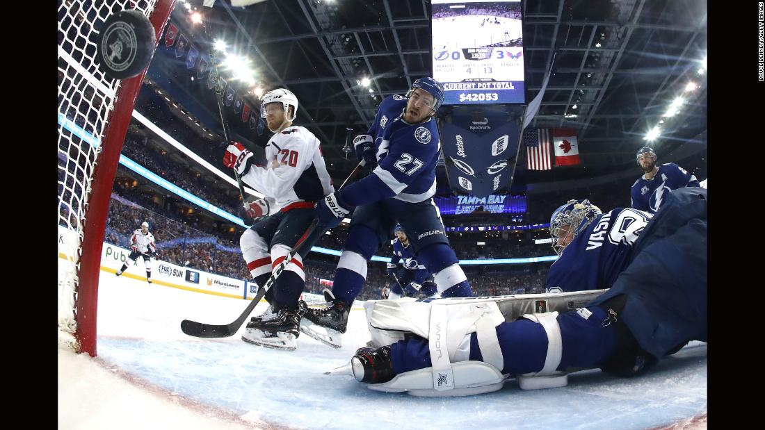 Lars Eller (20) of the Washington Capitals scores a goal against Andrei Vasilevskiy (88) of the Tampa Bay Lightning during the second period in Game 1 of the Eastern Conference Finals during the 2018 NHL Stanley Cup Playoffs at Amalie Arena on Friday, May 11, in Tampa, Florida.