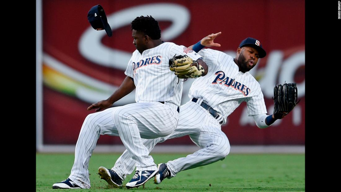 San Diego Padres second baseman Jose Pirela, left, collides with center fielder Manuel Margot while Pirela caught a popup hit by St. Louis Cardinals΄ Marcell Ozuna during the sixth inning of a baseball game in San Diego on Saturday, May 12.