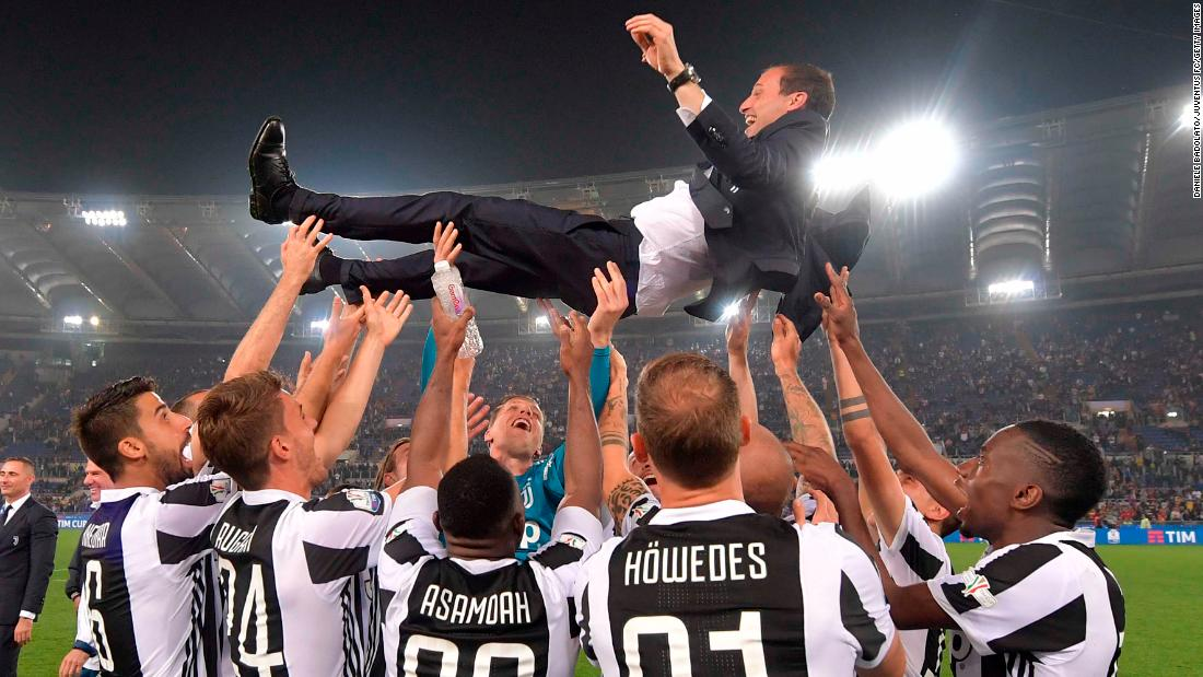 Juventus players and head coach  Massimiliano Allegri celebrate after winning the TIM Cup Final between Juventus and AC Milan at Stadio Olimpico on Wednesday, May 9, in Rome.