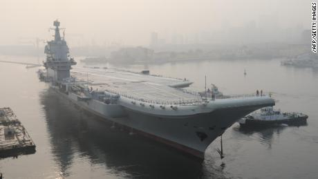 "China's first domestically manufactured aircraft carrier, known only as ""Type 001A"", leaves port in the northeast city of Dalian early on May 13, 2018. - China's first domestically manufactured aircraft carrier started sea trials on May 13, state media said, a landmark in Beijing's ambitious plans to modernise its navy as the Asian giant presses its claims in disputed regional waters. (Photo by - / AFP) / China OUT        (Photo credit should read -/AFP/Getty Images)"