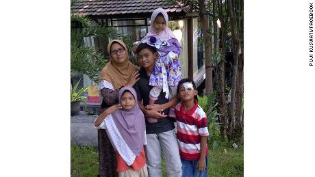 An old family photograph of Puji Kuswati and her children, who carried out suicide bombings in Surabaya on Sunday.