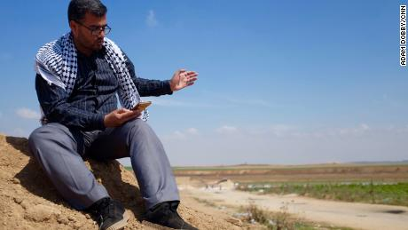 Protest leader Ahmad Abu Artema reads poetry near the Gaza border.