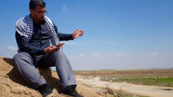 Protest leader Ahmad Abu Artema reads poetry near the Gaza border.