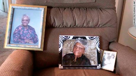 In this frame from video, photos of Lessie Brown rest on a chair at her Ohio home.