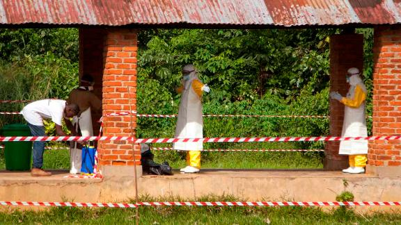 Health workers are sprayed with chlorine after leaving the isolation ward at Bikoro Hospital, the epicenter of the latest outbreak in the DRC.  Bikoro hospital has sealed off a ward to diagnose suspected Ebola patients and provide treatment.  The DRC has experienced nine known Ebola outbreaks.