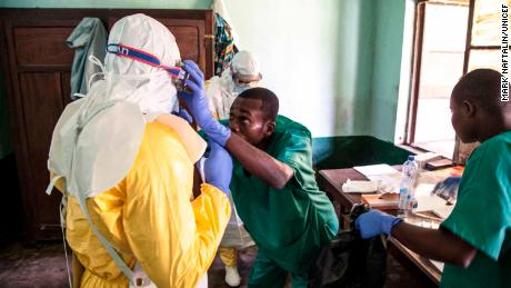 Health workers get ready to attend to suspected Ebola patients in Bikoro Hospital, the epicenter of the latest outbreak in the DRC.  The DRC has experienced nine known Ebola outbreaks.