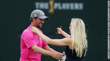 Webb Simpson celebrates with his wife Dowd after winning the Players Championship.