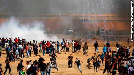 Israeli forces fire teargas canisters toward Palestinian demonstrators at the Gaza border on Friday, May 11.