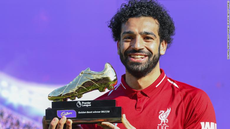 LIVERPOOL, ENGLAND - MAY 13: Mohamed Salah of Liverpool poses for a photo with his Premier League Golden Boot Award after the Premier League match between Liverpool and Brighton and Hove Albion at Anfield on May 13, 2018 in Liverpool, England. (Photo by Michael Regan/Getty Images)