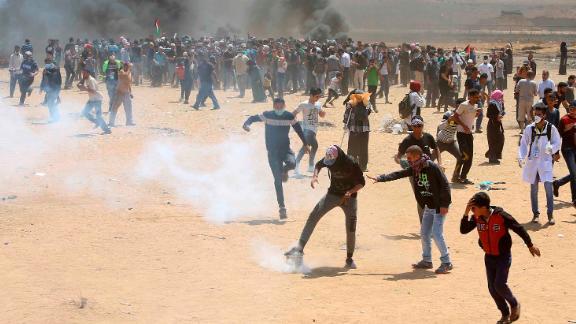 Palestinians demonstrate near the Gaza border fence on Monday.