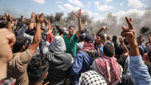Palestinians carry an injured protester during clashes with Israeli forces in Gaza on Monday.