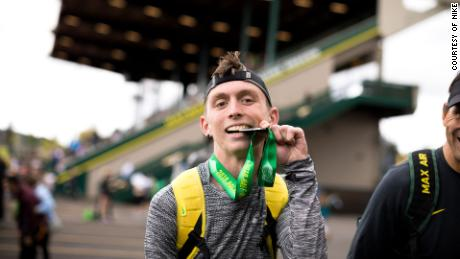 Gallegos proudly showing off his medal after completing the 2018 Eugene Half Marathon.