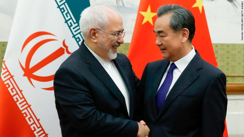 Chinese State Councillor and Foreign Minister Wang Yi (R) meets Iran's Javad Zarif at the Diaoyutai state guesthouse in Beijing on May 13.