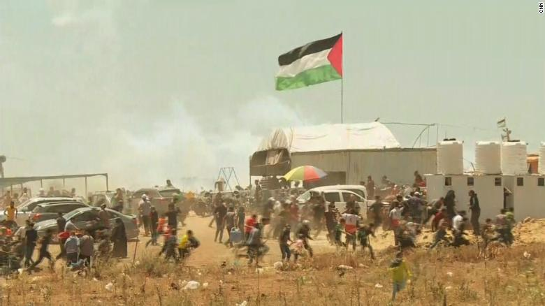 U.S. opens embassy as dozens killed in Gaza