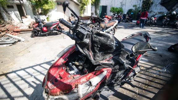 A damaged motorcycle is seen outside the Surabaya Centre Pentecostal Church in Surabaya on May 14.