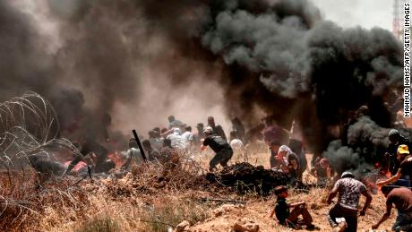 Palestinians clash with Israeli forces near the frontier between Gaza and Israel on May 14.