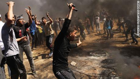 Palestinians protest near the border fence with Israel on Monday.