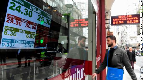 Currency exchange values are displayed in the buy-sell board of a bureau de exchange in Buenos Aires, on May 14, 2018. - Argentina's peso plummeted by more than 6 percent on Monday, sparking new inflation fears for Latin America's third-largest economy. The currency fell 6.6 percent to trade at 25.20 against the dollar as markets opened. (Photo by Eitan ABRAMOVICH / AFP)        (Photo credit should read EITAN ABRAMOVICH/AFP/Getty Images)
