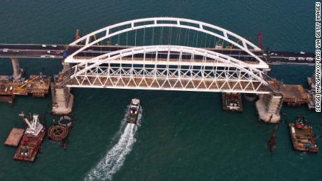 Russian President Vladimir Putin is set to preside over the official opening of a road-rail bridge across the Kerch Strait linking Crimea to Russia.