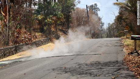 Toxic sulfur dioxide seeps out of the street in the community of Leilani Estates on the Big Island.