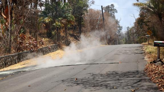 Toxic sulfur dioxide seeps out of a street in Leilani Estates, Hawaii.