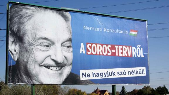 """A billboard with a poster of Hungarian-American billionaire and philanthropist George Soros with the lettering """"National consultation about the Soros"""
