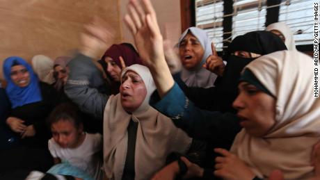 On Tuesday, women mourn the death of a Palestinian protester killed the day before in Gaza.