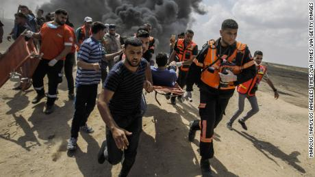 Medical units carry away a wounded Palestinian during a protest at the Gaza border on Monday.
