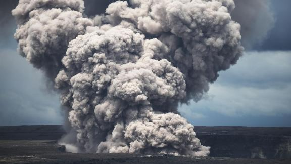 An ash plume rises from the Halemaumau crater within the Kilauea volcano summit caldera.