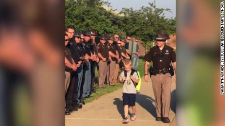 Cops escort boy to school