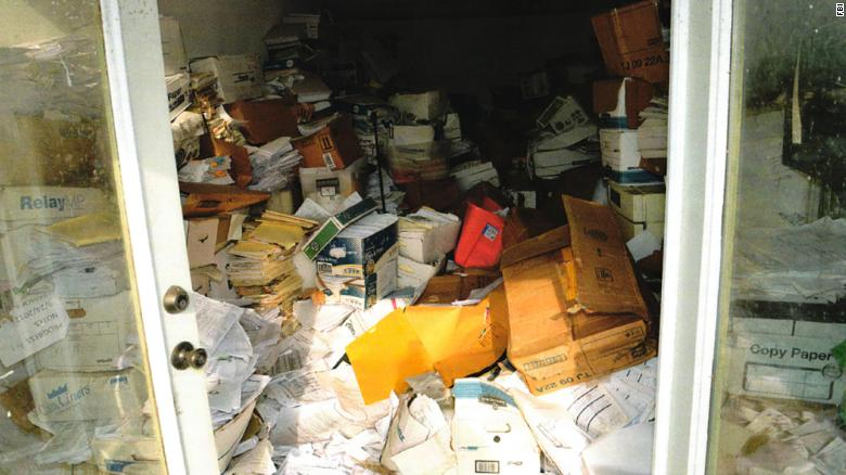 Court documents include photos of what may be patient records kept in an unsecure building.