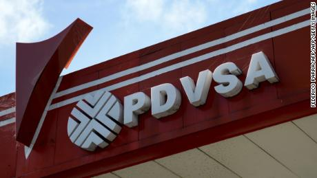 "Picture of the logo of Venezuelan state-owned oil company PDVSA, seen at a gas station in Caracas, on November 14, 2017. Venezuela has been declared in ""selective default"" by Standard and Poor's after failing to make interest payments on bond issues as it tries to refinance its $150 billion foreign debt. / AFP PHOTO / Federico PARRA        (Photo credit should read FEDERICO PARRA/AFP/Getty Images)"