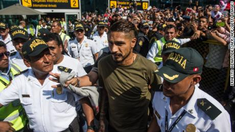 "Peru's national football team captain Paolo Guerrero, arrives at the Jorge Chavez airport in Lima on May 15, 2018 a day after the Court of Arbitration for Sport (CAS) increased a previous sanction by imposing a 14-month doping ban on him. - Striker Guerrero had been included in Peru's preliminary 25-man World Cup squad announced on Sunday after an initial six-month ban imposed by world football governing body FIFA expired earlier this month. But less than a week after he attended a CAS hearing in a bid to completely annul a ban for testing positive for traces of cocaine, CAS increased his sentence for falling foul of ""an anti-doping rule violation (presence of Benzoylecgonine metabolites)"". (Photo by Ernesto BENAVIDES / AFP)        (Photo credit should read ERNESTO BENAVIDES/AFP/Getty Images)"