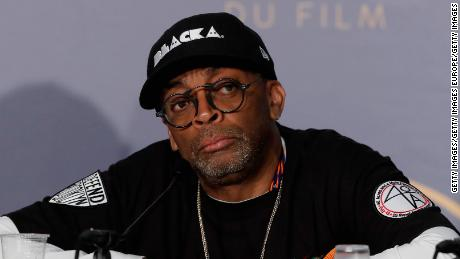 "CANNES, FRANCE - MAY 15:  Spike Lee speaks at the press conference for ""BlacKkKlansman"" during the 71st annual Cannes Film Festival at Palais des Festivals on May 15, 2018 in Cannes, France.  (Photo by Sebastien Nogier/EPA Pool/Getty Images)"