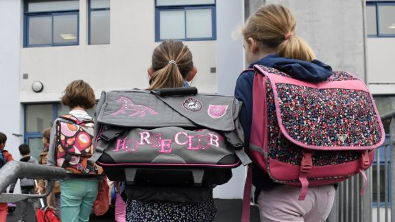 Pupils enter their classroom in a primary school on the first day of the new school year on September 4, 2017, in Quimper, western France. / AFP PHOTO / FRED TANNEAU        (Photo credit should read FRED TANNEAU/AFP/Getty Images)