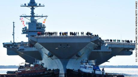 NEWPORT NEWS, VA - APRIL 8:  In this handout photo provided by the U.S. Navy, sailors aboard the aircraft carrier Pre-Commissioning Unit (PCU) Gerald R. Ford (CVN 78) man the rails as the ship departs Huntington Ingalls Industries Newport News Shipbuilding for builder's sea trials off the U.S. East Coast on April 8, 2017 in Newport News, Virginia. The first-of-class ship, the first new U.S. aircraft carrier design in 40 years, will spend several days conducting builder's sea trials, a comprehensive test of many of the ship's key systems and technologies. (Photo by Chief Mass Communication Specialist Christopher Delano/U.S. Navy via Getty Images)