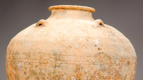 A Chinese storage jar from the Java Sea Shipwreck. These jars would have held spices, dried tea leaves, fish sauce, pickled2vegetables, and other perishable goods. Some of these jars have cyclical date stamps on them.Photo © The Field Museum, cat. no. 350475.