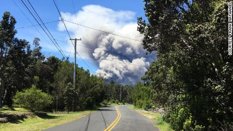 Ash plume is visible Tuesday near the Volcano Golf & Country Club, about 2 miles from Kilauea's crater.