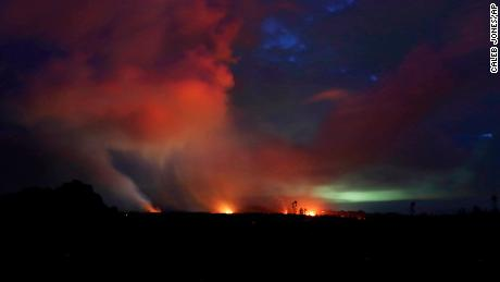 Lava shoots into the night sky from active fissures on the lower east rift of Kilauea volcano, Tuesday, May 15, 2018 near Pahoa, Hawaii. (AP Photo/Caleb Jones)