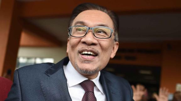 Jailed former opposition leader and current Federal opposition leader Anwar Ibrahim greets supporters after his release from the Cheras Hospital Rehabilitation in Kuala Lumpur on May 16, 2018. - The release of Anwar from prison marks yet another sharp turn in a roller-coaster political life that has left a profound mark on Malaysian politics and society. Anwar was pardoned and released on on May 16, 2018 after serving three years for a sodomy conviction widely considered a railroad job and now quashed following the stunning defeat of a Malaysian regime that had ruled for six decades. (Photo by MOHD RASFAN / AFP)        (Photo credit should read MOHD RASFAN/AFP/Getty Images)