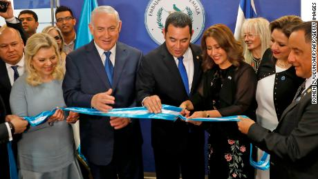 (L to R) Sara Netanyahu and her husband Israeli Prime Minister Benjamin applaud as Guatemalan President Jimmy Morales and his wife Hilda Patricia Marroquin cut the ribbon during the inauguration ceremony of the Guatemalan embassy in Jerusalem on May 16, 2018, also attended by Guatemalan Foreign Minister Sandra Jovel Polanco. - Guatemala inaugurated its Israel embassy in Jerusalem on May 15, becoming the first country to follow in the footsteps of the United States' deeply controversial move, breaking with decades of international consensus. (Photo by RONEN ZVULUN / POOL / AFP)        (Photo credit should read RONEN ZVULUN/AFP/Getty Images)