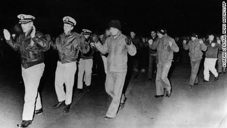 Crew from the USS Pueblo being captured by North Korea on January 23, 1968.