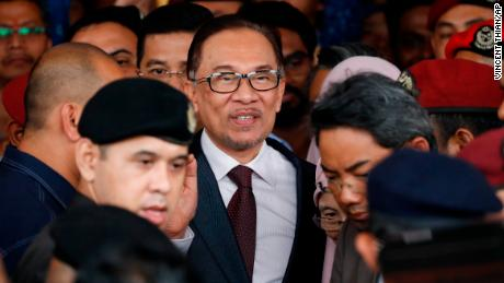 Malaysia jailed opposition icon Anwar Ibrahim waves to supporters as he leave a hospital in Kuala Lumpur, Malaysia, Wednesday, May 16, 2018. Prime Minister Mahathir Mohamad said Malaysia's king had agreed to pardon Anwar, who was jailed in 2015 for sodomy in a conviction that he said was politically motivated. (AP Photo/Vincent Thian)