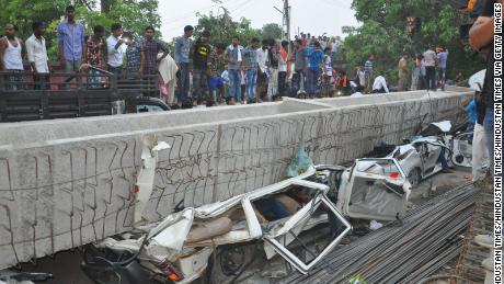 At least four cars were crushed when a section of an overpass collapsed on Tuesday evening, in Varanasi, India.