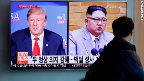 "FILE - In this May 11, 2018, file photo, a man watches a TV screen showing file footage of U.S. President Donald Trump, left, and North Korean leader Kim Jong Un during a news program at the Seoul Railway Station in Seoul, South Korea. The outcome of South Korean President Moon Jae-in's efforts may hinge on a meeting in Singapore in June between Kim and Trump, who spent months contemplating military strikes against the North before Moon steered him to the table. The letters read ""Summit between U.S. and North Korea, Forecast, Clear."" (AP Photo/Lee Jin-man)"