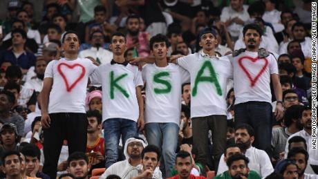 JEDDAH, SAUDI ARABIA - SEPTEMBER 05:  Saudi Arabia supporters cheer prior to the FIFA World Cup qualifier match between Saudi Arabia and Japan at the King Abdullah Sports City on September 5, 2017 in Jeddah, Saudi Arabia.  (Photo by Kaz Photography/Getty Images)